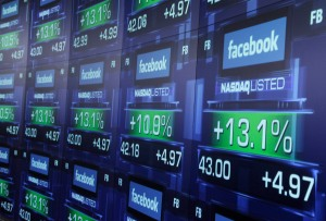 "FILE - In this Friday, May 18, 2012 file photo, electronic screens show the price of Facebook shares after they began trading in New York. A flood of analyst reports from the banks that led Facebook's initial public offering gave the company's stock a mix of ""Neutral"" and ""Buy"" ratings on Wednesday, June 27, 2012 The day marks the end of a 40-day quiet period following the IPO, during which the underwriters aren't allowed to issue ratings. (AP Photo/Richard Drew)"