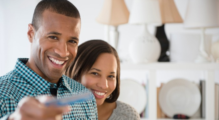 pic for blog 13 portrait-of-happy-couple-paying-with-credit-card-in-store-2